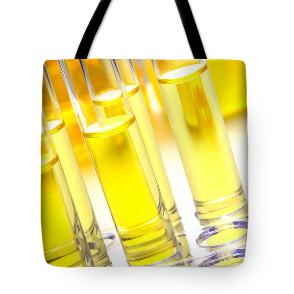 Tote Bag featuring the photograph Laboratory Test Tubes In Science Research Lab by Olivier Le Queinec