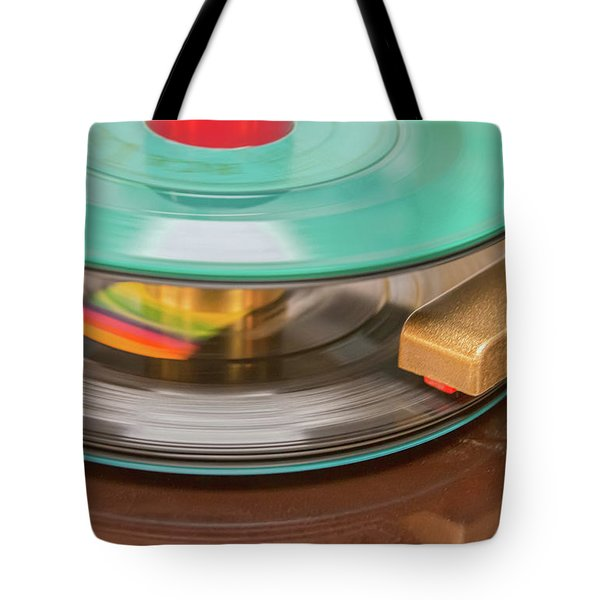 Tote Bag featuring the photograph 45 Rpm Record In Play Mode by Gary Slawsky