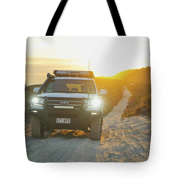 4wd Car Explores Sand Track In Early Morning Light Tote Bag