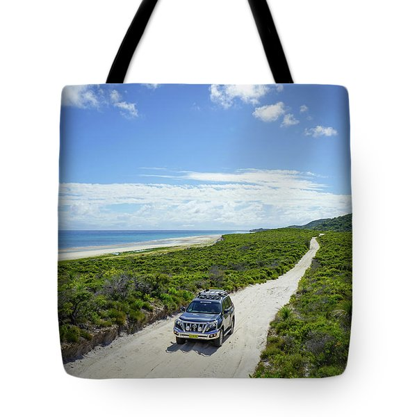 4wd Car Exploring Remote Track On Sand Island Tote Bag