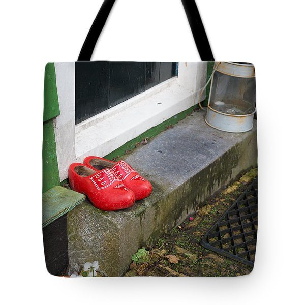 Tote Bag featuring the photograph Wooden Shoes by Hans Engbers