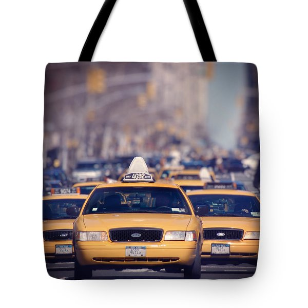 Tote Bag featuring the photograph 5th Avenue Cabs by Ray Devlin