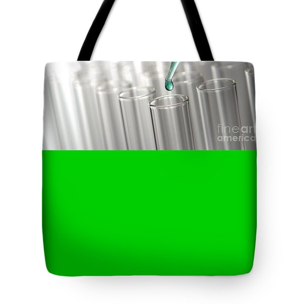Tote Bag featuring the photograph Test Tubes In Science Research Lab by Olivier Le Queinec