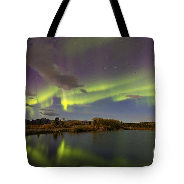 Aurora Borealis With Moonlight At Fish Tote Bag by Joseph Bradley