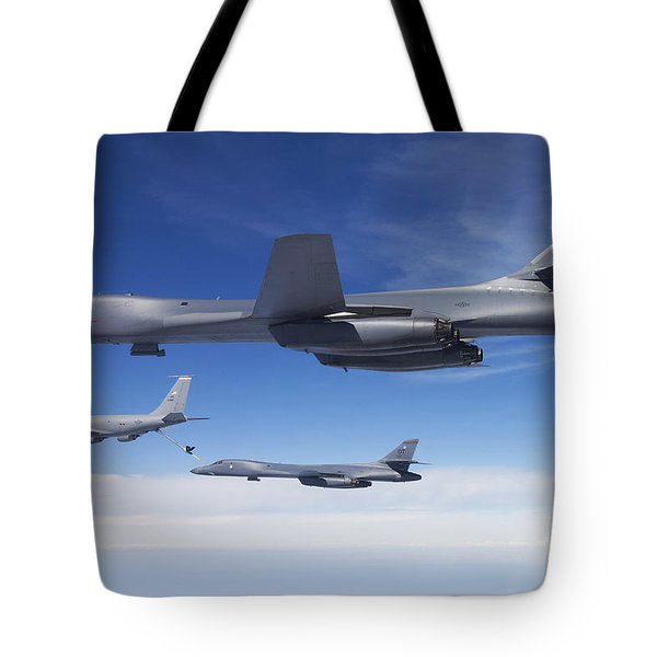 A B-1b Lancer Stands By As Another Tote Bag by Stocktrek Images
