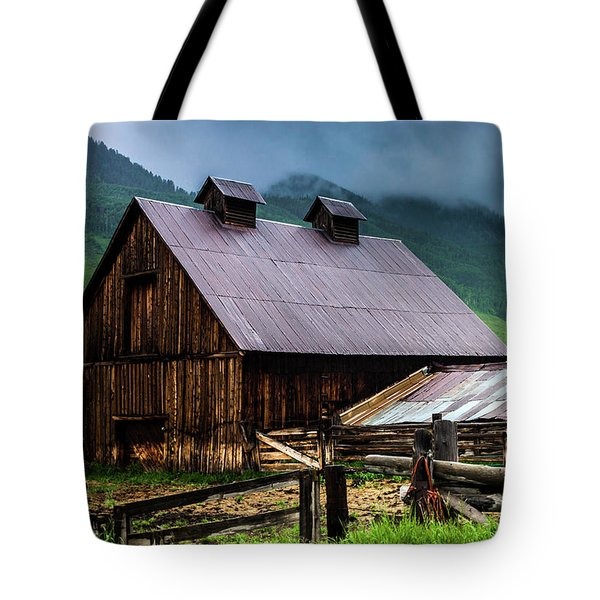 Tote Bag featuring the photograph A Barn In Crested Butte by John De Bord