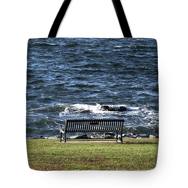 Tote Bag featuring the photograph A Bench By The Sea by Tom Prendergast