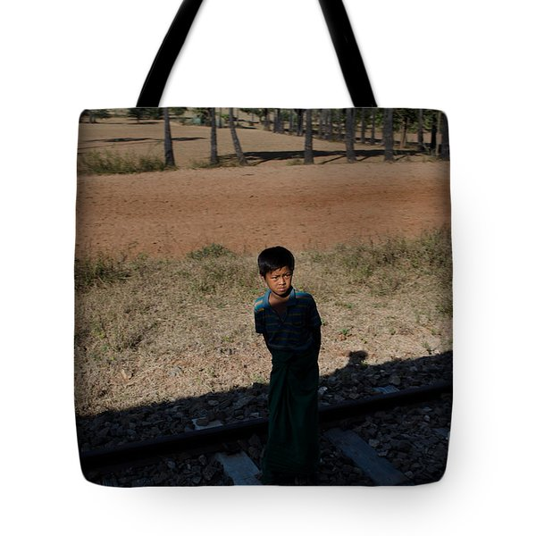 A Boy In Burma Looks Towards A Train From The Shadows Tote Bag by Jason Rosette
