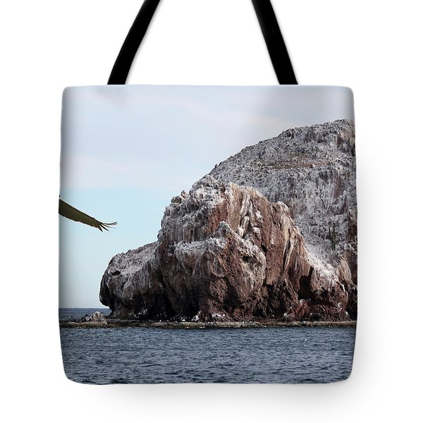 A Brown Pelican Does A Flyby Of A Guano Covered Desert Island  Tote Bag