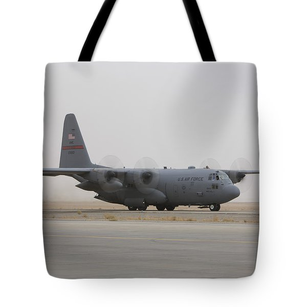 A C-130 Hercules Aircraft Taxis Tote Bag by Terry Moore
