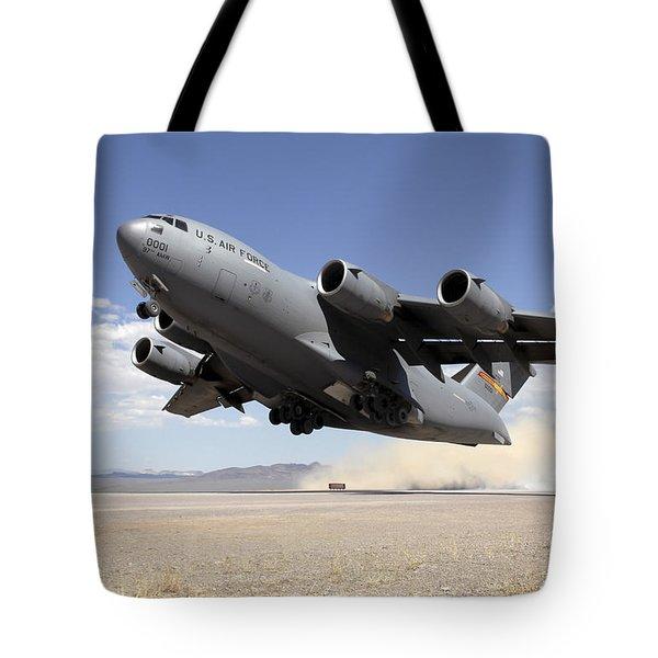 A C-17 Globemaster Departs Tote Bag by Stocktrek Images