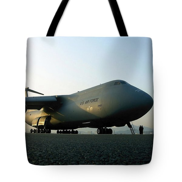 A C-5 Galaxy Sits On The Flightline Tote Bag by Stocktrek Images