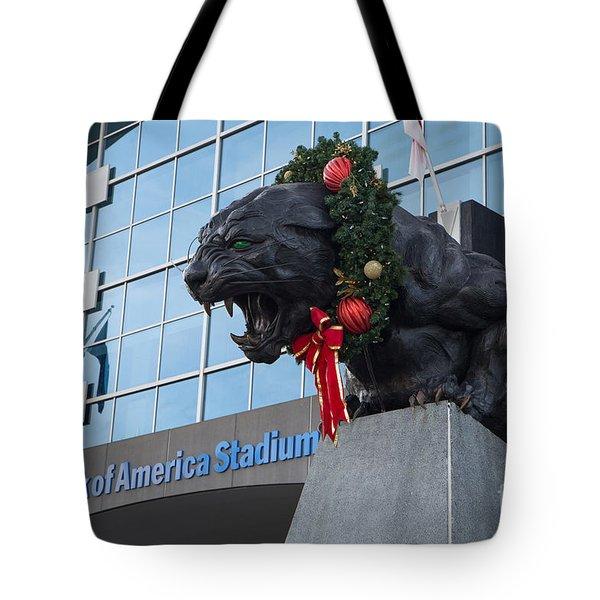 A Carolina Panthers Christmas Tote Bag by Kevin McCarthy
