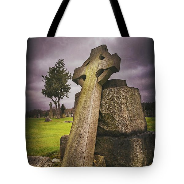 Tote Bag featuring the photograph A Celtic Cross In Glasgow Scotland by Carol Japp