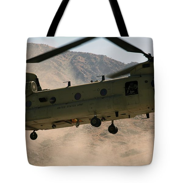 A Ch-47 Chinook Helicopter Kicks Tote Bag by Stocktrek Images