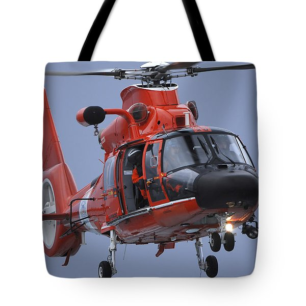 A Coast Guard Mh-65 Dolphin Helicopter Tote Bag by Stocktrek Images