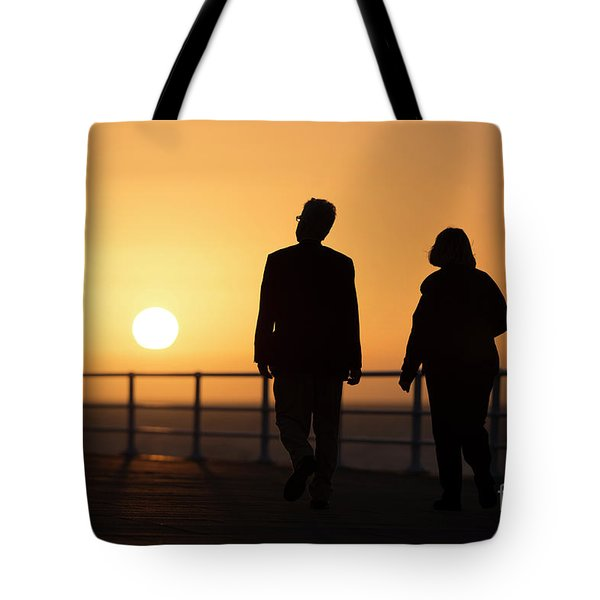 A Couple In Silhouette Walking Into The Sunset Tote Bag