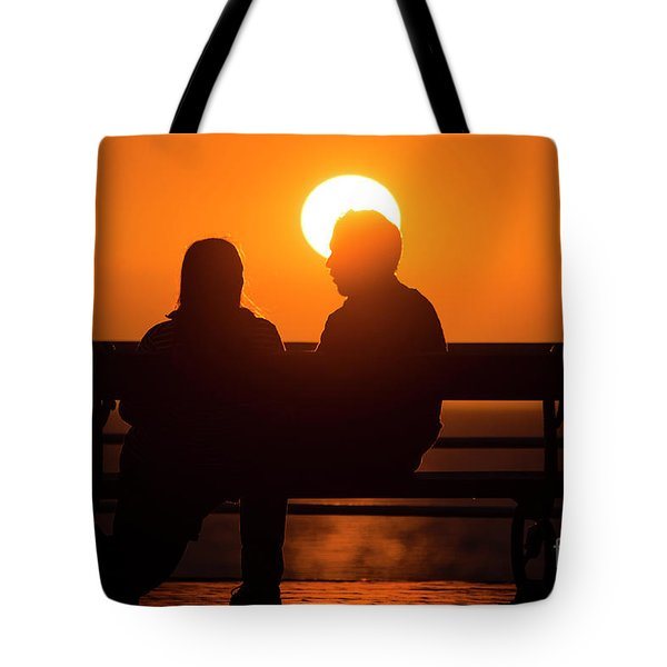 A Couple Sitting At Sunset Tote Bag