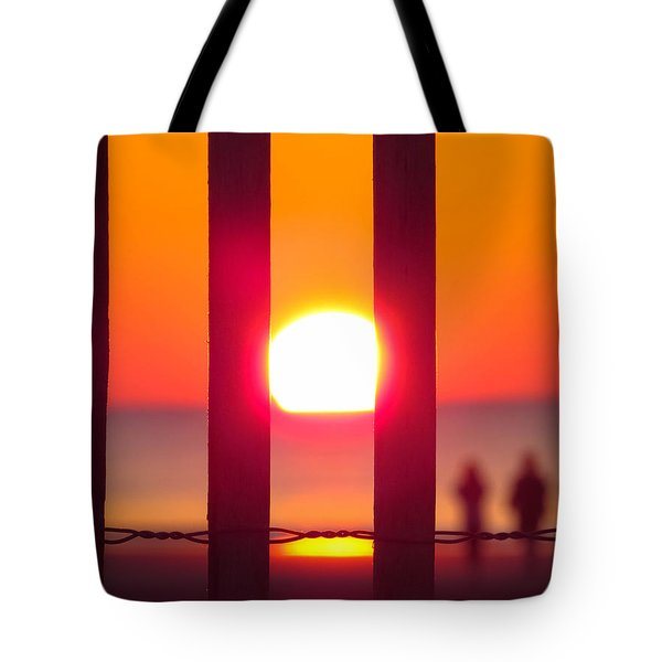 Tote Bag featuring the photograph A Couple's Sunrise by Nikki McInnes