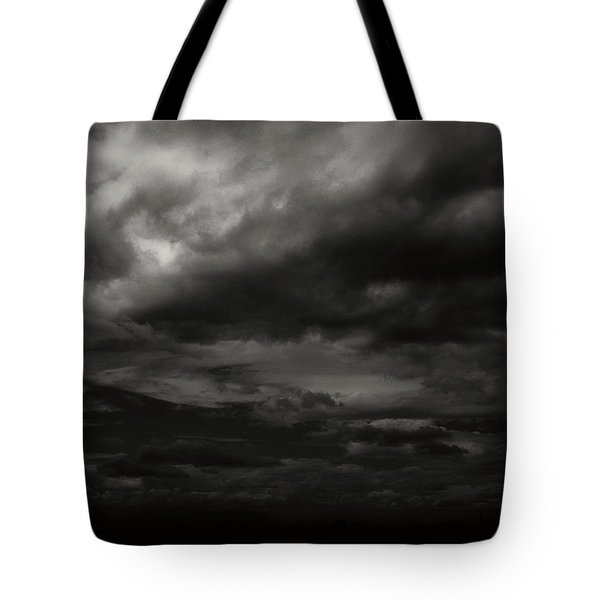 Tote Bag featuring the photograph A Dark Moody Storm by John Norman Stewart