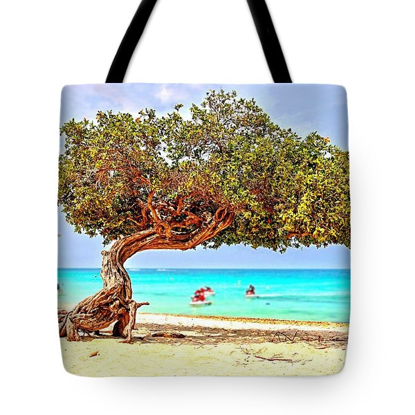 Tote Bag featuring the photograph A Day At Eagle Beach by DJ Florek