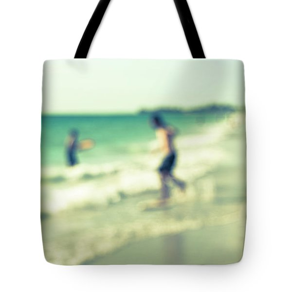 Tote Bag featuring the photograph a day at the beach III by Hannes Cmarits