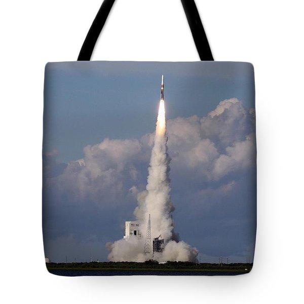 A Delta Iv Rocket Soars Into The Sky Tote Bag