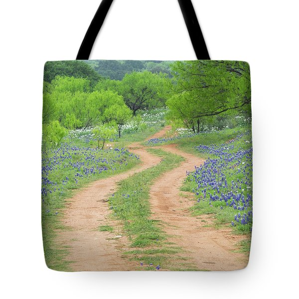 A Dirt Road Lined By Blue Bonnets Of Texas Tote Bag