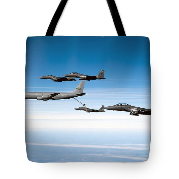A F-15e Strike Eagle Is Refueled Tote Bag by Stocktrek Images