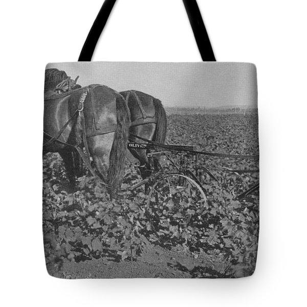 A Farmer Using A Cultivator  Tote Bag