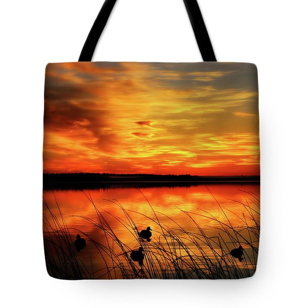 Tote Bag featuring the photograph A Golden Sunrise Duck Hunt by Dale Kauzlaric