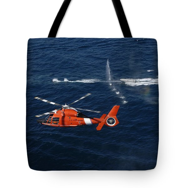 A Helicopter Crew Trains Off The Coast Tote Bag by Stocktrek Images