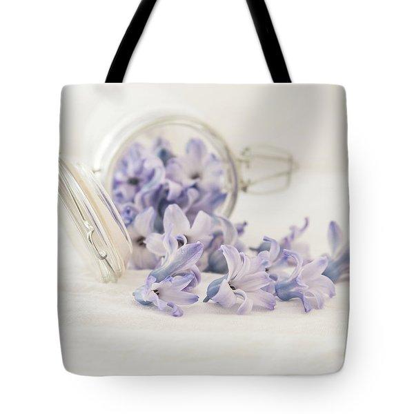 Tote Bag featuring the photograph A Jar Of Purple Sweetness by Kim Hojnacki