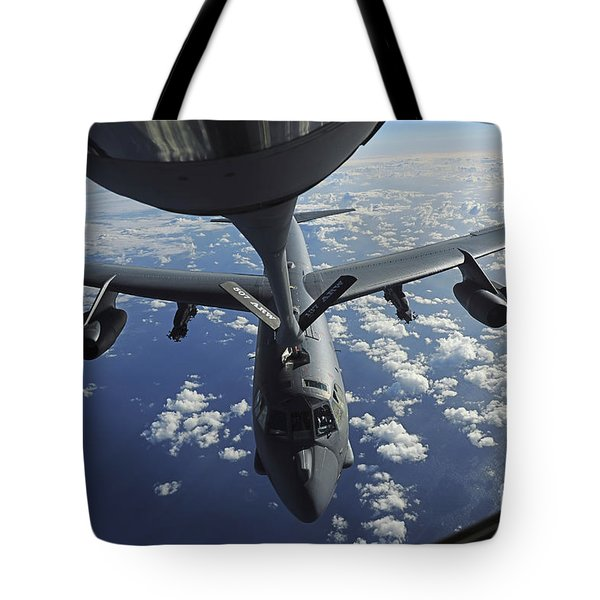 A Kc-135 Stratotanker Aircraft Refuels Tote Bag by Stocktrek Images