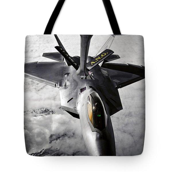A Kc-135 Stratotanker Refuels A F-22 Tote Bag by Stocktrek Images