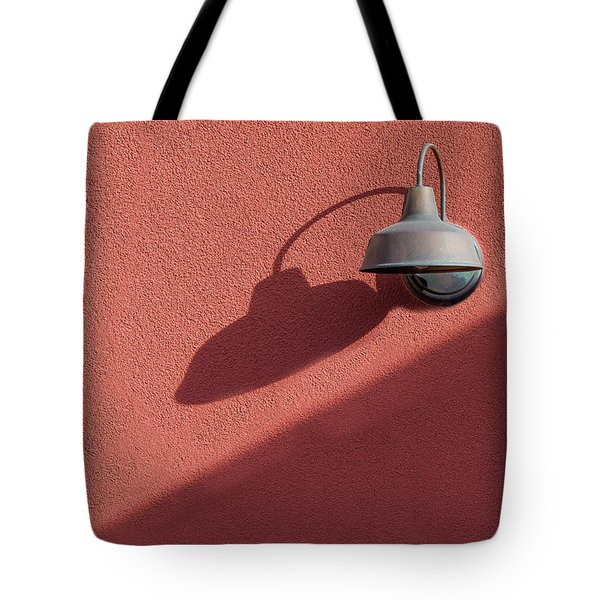 Tote Bag featuring the photograph A Light Alone by Paul Wear