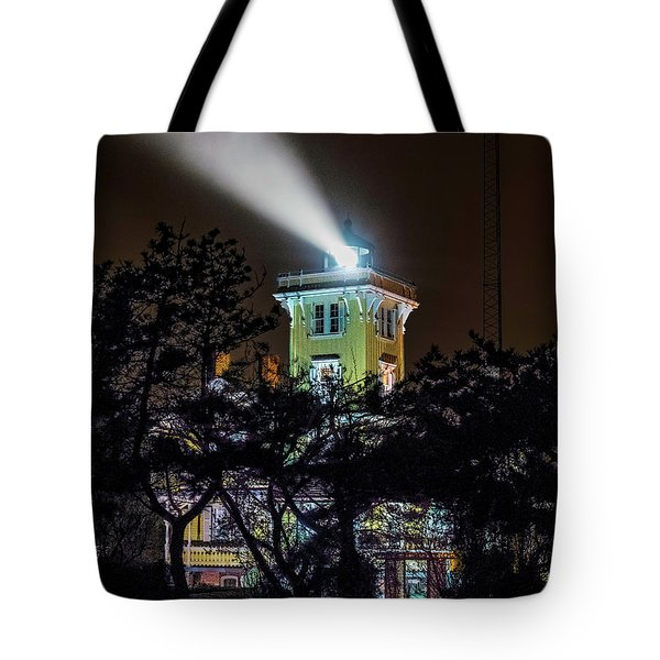 Tote Bag featuring the photograph A Light In The Darkness by Nick Zelinsky