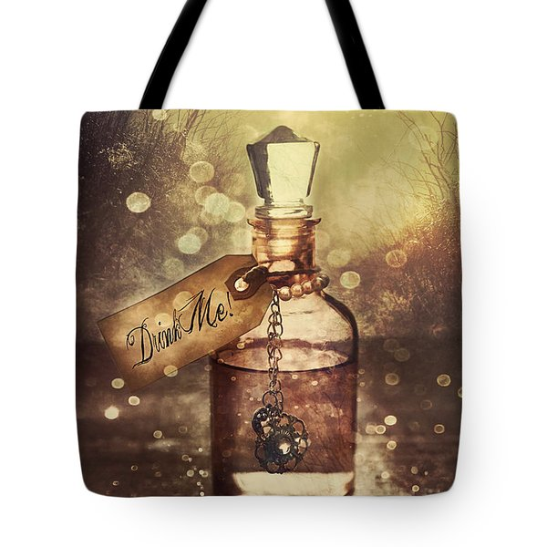 A Little Bottle With A Potion That Says Drink Me Tote Bag by Sandra Cunningham