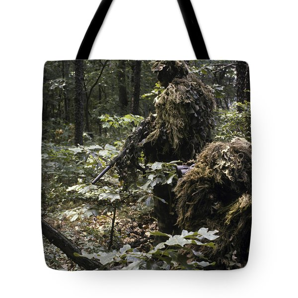A Marine Sniper Team Wearing Camouflage Tote Bag by Stocktrek Images