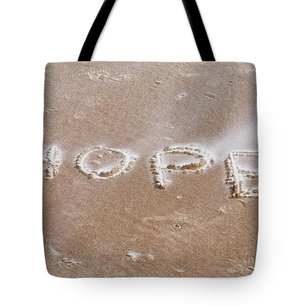 Tote Bag featuring the photograph A Message On The Beach by John M Bailey