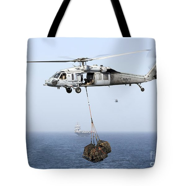 A Mh-60 Helicopter Transfers Cargo Tote Bag by Gert Kromhout