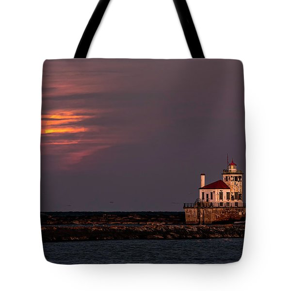 Tote Bag featuring the photograph A Moonsetting Sunrise by Everet Regal