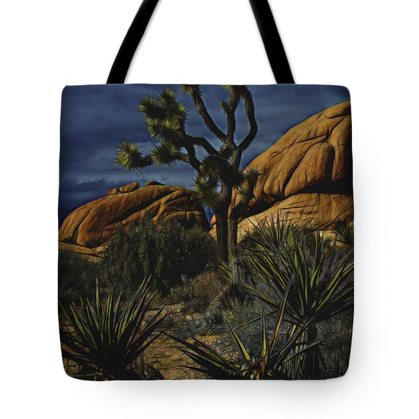 Tote Bag featuring the photograph A Mysterious Stormy Desert Sky by Photography by Laura Lee