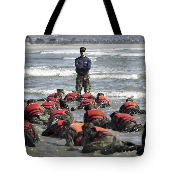 A Navy Seal Instructor Assists Students Tote Bag by Stocktrek Images