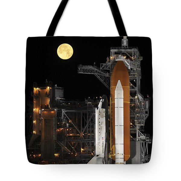 A Nearly Full Moon Sets As Space Tote Bag by Stocktrek Images