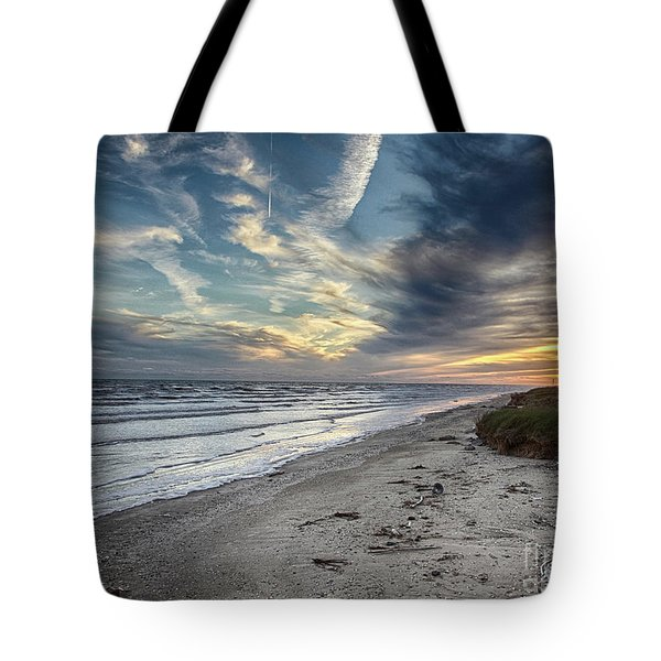 Tote Bag featuring the photograph A Peaceful Beach Sunset by Charles McKelroy