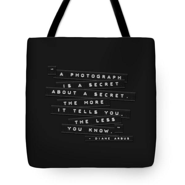 Tote Bag featuring the photograph A Photograph Is A Secret Embossed Labels by Brian Carson