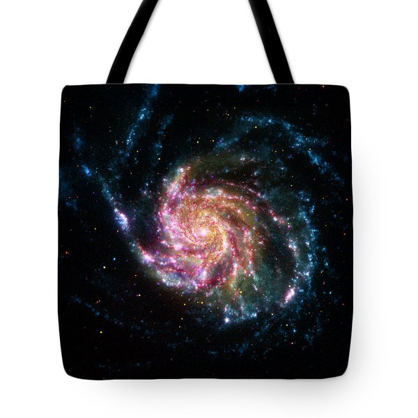Tote Bag featuring the pyrography A Pinwheel In Many Colors by Artistic Panda