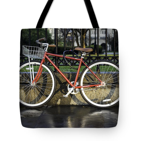 A Red Bicycle Near Jackson Square, New Orleans, Louisian Tote Bag