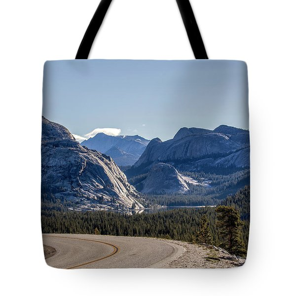 Tote Bag featuring the photograph A Road To Follow by Everet Regal